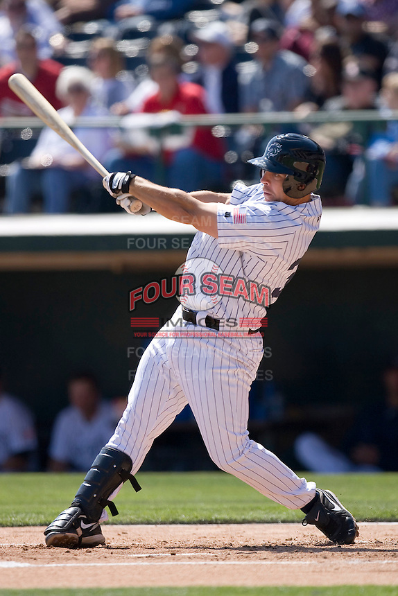 Brian Myrow #33 of the Charlotte Knights follows through on his swing versus the Gwinnett Braves at Knights Castle April 9, 2009 in Fort Mill, South Carolina. (Photo by Brian Westerholt / Four Seam Images)