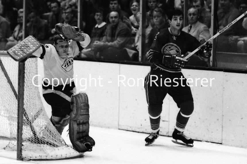 Los Angeles Kings goalie Gerry Desjardins or Denis Dejordy behind the net , Seals Carol Vadnais.<br />(1969 photo by Ron Riesterer)