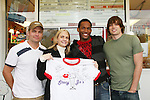 Lawrence Saint-Victor & Zack Conroy and fan - Guiding Light's actors meet fans at Stacy Jo's Ice Cream in McKees Rocks, PA on September 30, 2009. During the weekend of events proceeds from pink ribbon bagel sales at various Panera Bread locations will benefit the Young Women's Breast Cancer Awareness Foundation. (Photo by Sue Coflin/Max Photos)