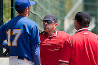 24 May 2009: Home plate umpire Franck Benasseur talks to Matthieu Brelle Andrade during the 2009 challenge de France, a tournament with the best French baseball teams - all eight elite league clubs - to determine a spot in the European Cup next year, at Montpellier, France. Senart wins 8-5 over La Guerche.