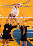 BROOKINGS, SD - NOVEMBER 14:  Tiara Gibson #7 from South Dakota State University looks to get a kill between Sara Pope #11 and Shelby Cox #2 from Oral Roberts University during their volleyball match Friday night at Frost Arena. (Photo by Dave Eggen/Inertia)