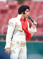 Elvis impersonator Michael St. Angel performs before a Kane County Cougars against the Clinton LumberKings at Coveleski Stadium on August 16, 2012 in South Bend, Indiana.  Kane County defeated Clinton 5-3.  (Mike Janes/Four Seam Images)