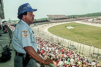 Security guard watches the Winston 500, Talladega Superspeedway, Talladega, Alabama, May 1992.(Photo by Brian Cleary/bcpix.com)