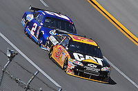 Apr 26, 2009; Talladega, AL, USA; NASCAR Sprint Cup Series driver Jeff Burton (31) leads Kurt Busch (2) during the Aarons 499 at Talladega Superspeedway. Mandatory Credit: Mark J. Rebilas-