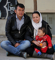 Pictured L-R: 19 year old Ruhoula from Afghanistan with his 18 year old wife Zakia and their 12 month old son Abulfaz in a street near Victoria Square Tuesday 08 March 2016<br />
