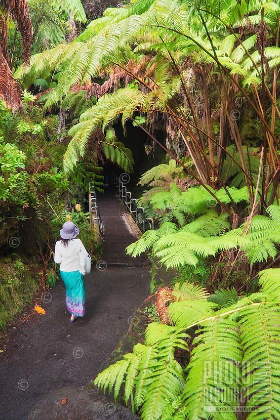 A woman entering the Thurston Lava Tube, Hawai'i Volcanoes National Park, Kilauea, Big Island.