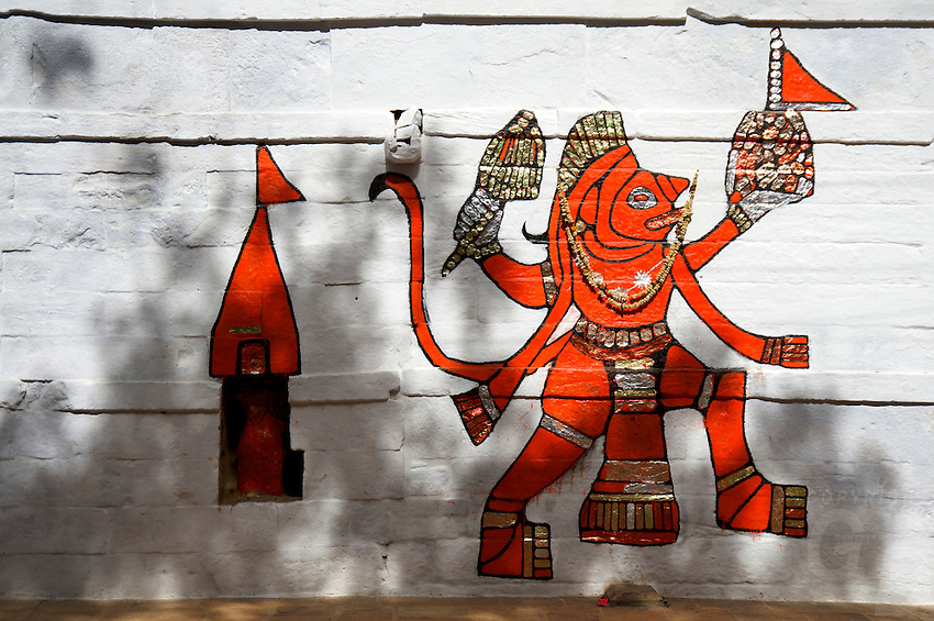 """painting of the Monkey God, Jaisalmer the old City and fort.J a i s a l m e r   J a i s a l m e r  n i c k n a m e d   """" T h e   G o l d e n   C i t y """" ,   i s   a   t o w n   i n   t h e   I n d i a n   s t a t e   o f   R a j a s t h a n .   T h e   t o w n   s t a n d s   o n   a   r i d g e   o f   y e l l o w i s h   s a n d s t o n e ,   c r o w n e d   b y   a   f o r t ,   w h i c h   c o n t a i n s   t h e   p a l a c e   a n d   s e v e r a l   o r n a t e   J a i n   t e m p l e s .   M a n y   o f   t h e   h o u s e s   a n d   t e m p l e s   a r e   f i n e l y   s c u l p t u r e d .   I t   l i e s   i n   t h e   h e a r t   o f   t h e   T h a r   D e s e r t   a n d   h a s   a   p o p u l a t i o n   o f   a b o u t   7 8 , 0 0 0 .   I t   i s   t h e   a d m i n i s t r a t i v e   h e a d q u a r t e r s   o f   J a i s a l m e r   D i s t r i c t ....Jaisalmer Fort is one of the largest of desert forts of the world. It is situated in Jaisalmer city in Indian state of Rajasthan. It was built in 1156 AD by the Bhati Rajput ruler Rawal Jaisal, from where it derives it name. The fort stands proudly admist the golden stretches of the great Thar Desert, on Trikuta Hill and had been the scene of many battles. Its massive yellow sandstone walls are a tawny lion color during the day, turning to a magical honey-gold as the sun sets and camouflages the fort making it appear a part of the picturesque yellow desert. Thus, it is also known as the """"Golden Fort"""".."""