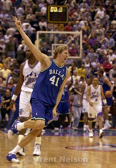 Dirk Nowitzki celebrates victory as the Utah Jazz face the Dallas Mavericks in game five of their first round playoff series, in Salt Lake City Thursday.  05/03/2001<br />