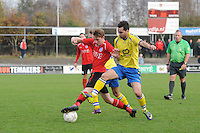 VOETBAL: HEERENVEEN: 23-11-2014, Sportpark Skoatterwâld, VV Heerenveen - SC Emmeloord, uitslag 2 - 1, Jordi Kouwenhoven (#10) links, Gokhan Pala (SC Emmeloord), ©foto Martin de Jong