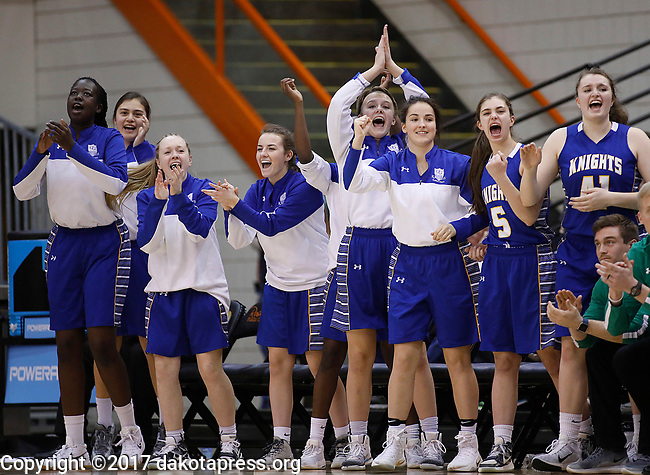 RAPID CITY, SD - MARCH 18, 2017 -- Players on the Sioux Falls O'Gorman bench celebrate a basket early against Harrisburg during the 2017 South Dakota State Class AA Girls Basketball Championship game Saturday at Barnett Arena in Rapid City, S.D.  (Photo by Dick Carlson/Inertia)