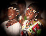 "In the town of Djibo in northern Burkina Faso, young ""doohoobe"" (people who sing ""doohaali"") dance in traditional fashion. The women clap their hands and sing as the men ""dooho,"" or sing a distinct, deep rhythmic chant.  ""Doohaali"" is a distinct form of music practiced only by the Fulani in Djelgooji, a particular area of Burkina Faso. The young women in this image are the winners of a regional music and arts competition, going on to perform at Burkina Faso's 2010 ""Semaine Nationale de la Culture"" (SNC) in Bobo-Dioulasso."