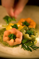 Four Colored Pasta in Shapes of Flowers On Pesto Sauce