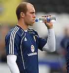 Steven Whittaker having a drink at Scotland training