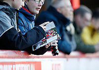 8th February 2020; Griffin Park, London, England; English Championship Football, Brentford FC versus Middlesbrough; Middlesbrough fan reading todays match programme - Strictly Editorial Use Only. No use with unauthorized audio, video, data, fixture lists, club/league logos or 'live' services. Online in-match use limited to 120 images, no video emulation. No use in betting, games or single club/league/player publications