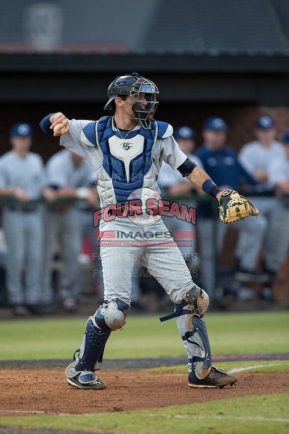 Catawba Indians catcher Zach Almond (23) on defense against the Belmont Abbey Crusaders at Abbey Yard on February 7, 2017 in Belmont, North Carolina.  The Crusaders defeated the Indians 12-9.  (Brian Westerholt/Four Seam Images)