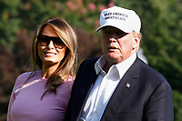 U.S. President Donald Trump walks with First Lady Melania Trump on the South Lawn of the White House upon their return to Washington on July 1, 2018 from Bedminster, NJ. <br /> CAP/MPI/RS<br /> &copy;RS/MPI/Capital Pictures