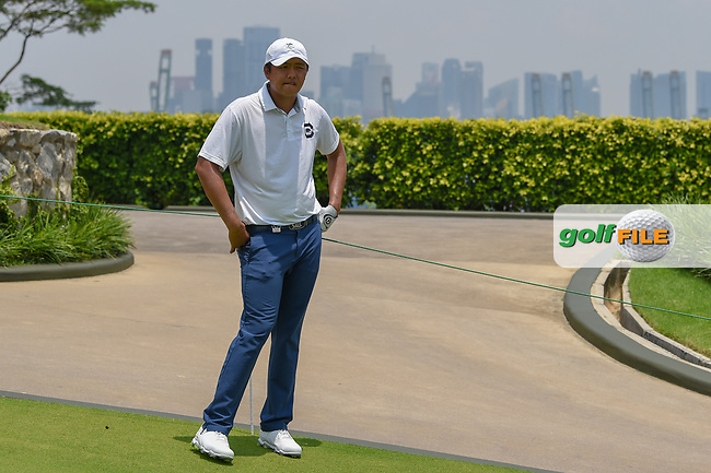 KK LIMBHASUT (THA) looks down 4 with the cityscape on the mainland in background during Rd 2 of the Asia-Pacific Amateur Championship, Sentosa Golf Club, Singapore. 10/5/2018.<br /> Picture: Golffile   Ken Murray<br /> <br /> <br /> All photo usage must carry mandatory copyright credit (© Golffile   Ken Murray)