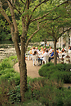 People picnicking at lakeside patio during Chateau Lorane winery's Memorial Day Fine Art & Wine Festival; Lorane Valley, Oregon..#9035-111