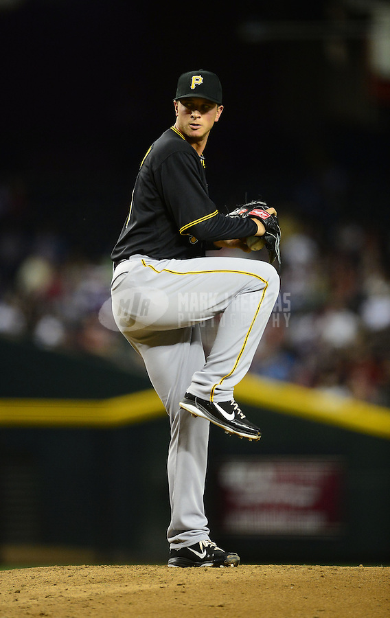 Apr. 17, 2012; Phoenix, AZ, USA; Pittsburgh Pirates pitcher Tony Watson winds up during game against the Arizona Diamondbacks at Chase Field. Mandatory Credit: Mark J. Rebilas-