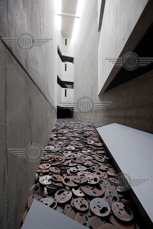 The Jewish Museum in Berlin, by architect Daniel Libeskind. The metal faces, leading into the void, are by the Israeli artist Menashe Kadishman.