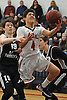 Benny Orlando #4 of MacArthur, right, drives to the hoop during a game against Hjemly (Ringe, Denmark) in the Jeff Shaw Memorial Basketball Tournament at MacArthur High School on Thursday, Dec. 1, 2016. He scored 16 points in MacArthur's 65-43 win.