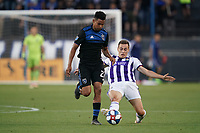 SAN JOSE, CA - JULY 16: Marcos Lopez #27 of the San Jose Earthquakes is defended by Jorge de Frutos #28 of Real Valladolid during a friendly match between the San Jose Earthquakes and Real Valladolid on July 16, 2019 at Avaya Stadium in San Jose, California.