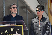 Gary Oldman &amp; Criss Angel at the Hollywood Walk of Fame Star Ceremony honoring illusionist Criss Angel. Hollywood Boulevard, Los Angeles, USA 20 July 2017<br /> Picture: Paul Smith/Featureflash/SilverHub 0208 004 5359 sales@silverhubmedia.com