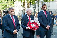 Picture by Allan McKenzie/SWpix.com - 25/08/2017 - Rugby League - Commemorative wreath laying ceremony - The Cenotaph, London, England - Wigan chairman Ian Lenagan is presented with a wreath to lay at the Cenotaph.