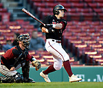 BOSTON, MA - APRIL 17: UMass' Nolan Kessinger hits an RBI double against Harvard in the third inning during the 30th Annual Baseball Beanpot Championship Game at Fenway Park in Boston, Massachusetts on April 17, 2019. Photo by Christopher Evans