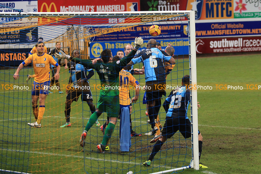Wycombe defender, Leon Johnson, heads the ball away to foil the Mansfield attack - Mansfield Town vs Wycombe Wanderers - Sky Bet League Two Football at the One Call Stadium, Mansfield - 25/01/14 - MANDATORY CREDIT: Paul Dennis/TGSPHOTO - Self billing applies where appropriate - 0845 094 6026 - contact@tgsphoto.co.uk - NO UNPAID USE