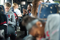 STANFORD, CA--Chiney Ogwumike engages with her smartphone on the bus ride to the airport en route to Norfolk, VA for the first and second rounds of the 2012 NCAA tournament.