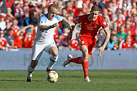 (L-R) Stanislav Lobotka of Slovakia and Will Vaulks of Wales in action during the UEFA EURO 2020 Qualifier match between Wales and Slovakia at the Cardiff City Stadium, Cardiff, Wales, UK. Sunday 24 March 2019