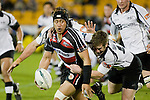 Tekori Luteru looks for support as he is tackled by Sam Giddens. Air New Zealand Cup rugby game between Counties Manukau Steelers & Hawkes Bay, played at Mt Smart Stadium on the 23rd of August 2007. Hawkes Bay won 38 - 14.