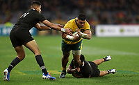 Tolu Latu of the Wallabies is tackled by Anton Lienert-Brown and Rieko Ioane of the All Blacks during the Rugby Championship match between Australia and New Zealand at Optus Stadium in Perth, Australia on August 10, 2019 . Photo: Gary Day / Frozen In Motion