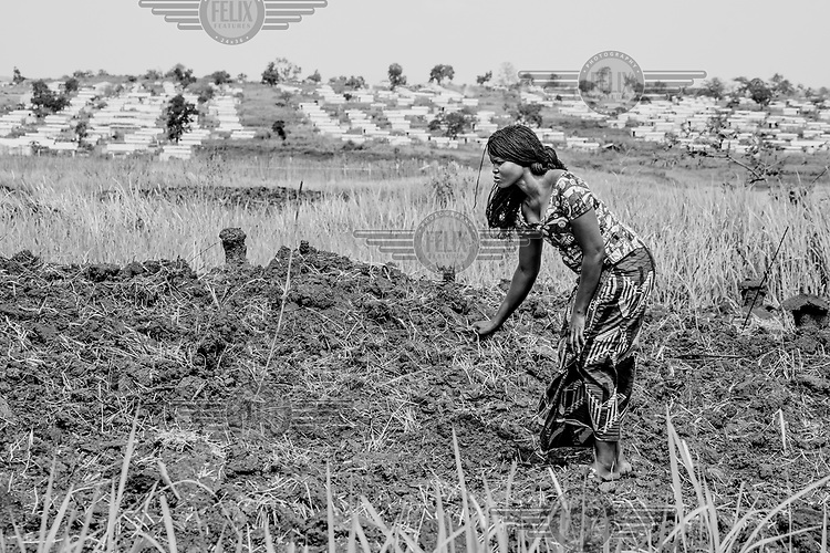 Twenty five year old Edwige, in addition to keeping a small vegetable garden outside her family's shelter, she plants crops on a wide swath of land at the edge of Mole camp for Central African refugees. Edwige escaped across the border from CAR to DRC after her fiance and son were killed in early 2013. Despite this unimaginable loss, she has devoted herself to helping others, and healing herself. An English teacher, primary school teacher, health centre liaison officer, SGBV focal point, RFI and capoiera club member, Edwige is also secretary general of the women's association and president of the association for malnourished children.