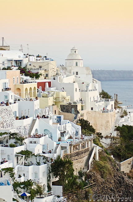 The village of Oia at dusk in Santorini, Greece.