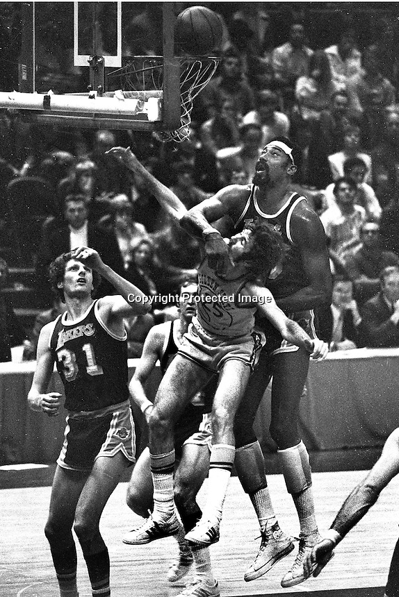 Golden State Warrior Jim Barnett is clobbered by Los Angles Laker Wilt Chamberlain during Warrior Lakers playoff 1973 (photo by Ron Riesterer)