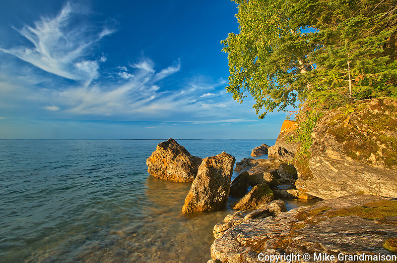 Rocky shoreline of Clearwater Lake at sunset<br />Clearwater Lake Provincial Park<br />Manitoba<br />Canada