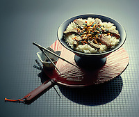 Oriental dish with meat and vegetables over white rice.