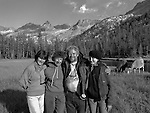 "(L-R) Sylvia Mayhew Desin, Ansel's granddaughter, Anne Adams Helms Ansel's daughter, Ken Helms, Virginia Mayhew Ansel's granddaughter.<br /> <br /> In August of 1987, the family and friends of Ansel Adams made a trip to Mount Ansel Adams to honor Ansel by putting his ashes on the mountain.  Leading the trip were Dr. Michael Adams and his wife, Jeanne, their son, Matthew, and daughter, Sarah.  Also in the group were Ansel's daughter, Anne Adams Helms, and her husband, Ken Helms, and Anne's daughters, Virginia (Ginny) Mayhew and Sylvia Mayhew Desin, and Sylvia's husband, Greg Desin.  Other members of the trip were Roger and Mitzi Hall, Matt Weston, Mrs. Desin (Greg's mother), and Billy Butler.  The Adams family invited me along with Leo Stutzin (Modesto Bee reporter) and my eldest son, Aaron Golub.  <br /> <br /> With some of us on horseback and others on foot, we began the hike at Tuolumne High Sierra Camp and headed to Vogelsang High Sierra Camp for the first night out.  The second day, we began by climbing through Vogelsang Pass, then descended by switchback down to Lewis Creek.  After climbing up from the creek we hiked by the Cony Crags before descending into the Lyell Fork of the Merced River ending up near Hutchings Creek at what is now referred to as the Ansel Adams Camp.  <br /> <br /> This camp was originally known generically as a Sierra Club Camp, but has more recently been referred to as Ansel Adams Camp because in 1934, Ansel led a Sierra Club outing to the Lyell Fork of the Merced River.  After the group climbed the then-unnamed peak that Adams called ""The Tower in Lyell Fork,"" they gathered around the campfire and agreed that the peak should bear Ansel's name.  The U.S. Geological Survey does not, however, permit naming features for living individuals, so the peak did not officially become Mt. Ansel Adams until 1985, one year and one day after his death.  Photo by Al Golub/Golub Photography"