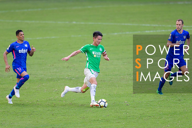 Wai Wong of Wofoo Tai Po (C) plays against Kitchee Forward Paulinho Carreiro (L) during the Hong Kong FA Cup final between Kitchee and Wofoo Tai Po at the Hong Kong Stadium on May 26, 2018 in Hong Kong, Hong Kong. Photo by Marcio Rodrigo Machado / Power Sport Images