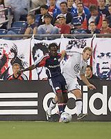 D.C. United defender Bryan Namoff (26) slows New England Revolution midfielder Sainey Nyassi (31) progress down the wing. The New England Revolution tied DC United, 2-2, in Gillette Stadium on May 29, 2008.