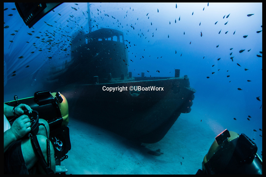 BNPS.co.uk (01202 558833)<br /> Pic: UBoatWorx/BNPS<br /> <br /> *Please use full byline*<br /> <br /> View of wreck from the explorer.<br /> <br /> A travel company has launched the ultimate in tourist day trips - visiting never-seen-before Roman shipwrecks 500ft below the surface in a James Bond-style submarines.<br /> <br /> For the first time ever adventurous daytrippers are being given the chance to join a marine archaeology expedition to research the newly-discovered 2,000-year-old wrecks off the coast of Sicily.<br /> <br /> But grockles wanting to join the pioneering mission will need deep pockets - because prices for the trip start at &pound;15,000 and go up to an eye-watering &pound;160,000.