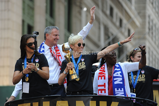 WWW.ACEPIXS.COM<br /> July 10, 2015 New York City<br /> <br /> Carli Lloyd,Mayor Bill de Blasio,Megan Rapinoe and Chirlane McCray  aboard a float in the New York City Ticker Tape Parade for World Cup Champions U.S.A. Women's Soccer National Team on July 10, 2015 in New York City.<br /> <br /> <br /> Credit: Kristin Callahan/ACE Pictures<br /> <br /> Tel: 646 769 0430<br /> e-mail: info@acepixs.com<br /> web: http://www.acepixs.com