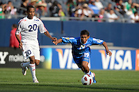 El Salvador's Reynaldo Hernandez plays the ball in front to Cuba's Alberto Gomez.  El Salvador defeated Cuba 6-1 at the 2011 CONCACAF Gold Cup at Soldier Field in Chicago, IL on June 12, 2011.