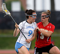 Jenn Russell (9) of North Carolina is defended by Caitlyn McFadden (3) of Maryland during the ACC women's lacrosse tournament finals in College Park, MD.  Maryland defeated North Carolina, 10-5.