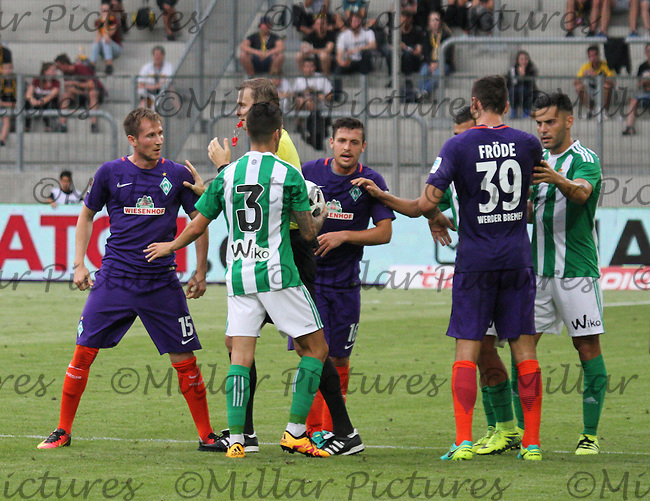 The referee pushes Izet Hajrovic away as tempers flare in the Werder Bremen v Real Betis match in the Bundeswehr Karriere Cup Dresden 2016 played at the DDV Stadion, Dresden on 29.7.16.