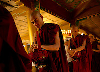 A Buddhist ritual of offering rice to monks in order to earn Karma. Myanmar