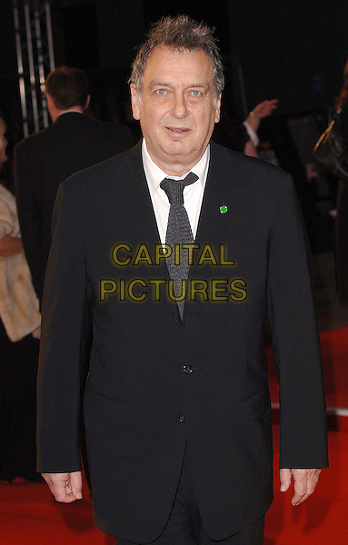 STEPHEN FREARS.Arriving at the 2007 Orange British Academy Film Awards (BAFTAs) at the Royal Opera House, London, England, 11th February 2007..half length black suit tie.CAP/ BEL.©Tom Belcher/Capital Pictures.