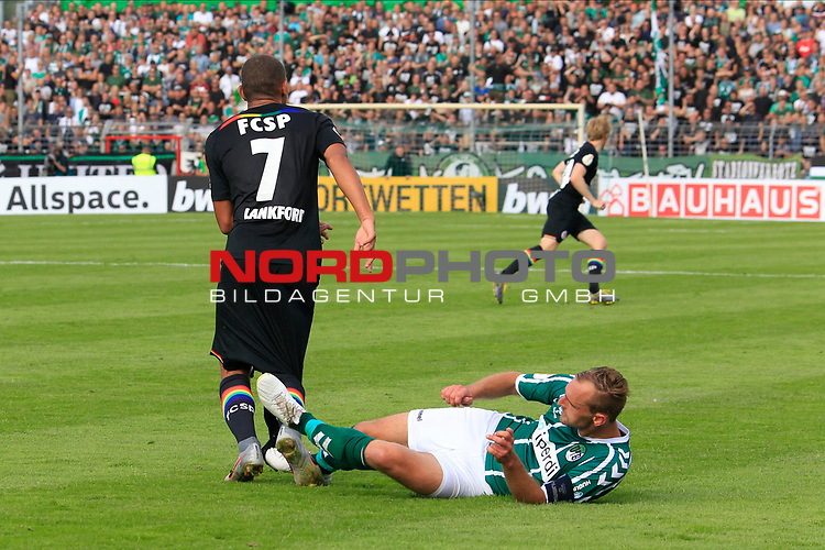 11.08.2019, Stadion Lohmühle, Luebeck, GER, DFB-Pokal, 1. Runde VFB Lübeck vs 1.FC St. Pauli<br /> <br /> DFB REGULATIONS PROHIBIT ANY USE OF PHOTOGRAPHS AS IMAGE SEQUENCES AND/OR QUASI-VIDEO.<br /> <br /> im Bild / picture shows<br /> Daniel Halke (VfB Luebeck) foult Kevin Lankford (FC St. Pauli).<br /> <br /> Foto © nordphoto / Freund